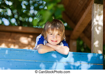 Boy, Leaning, On, Treehouse's, Wall, At, Playground
