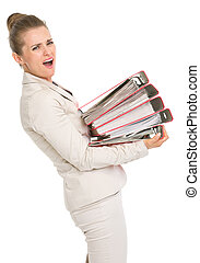 Frustrated business woman holding stack of folders