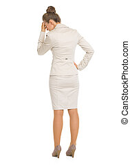 Full length portrait of frustrated business woman . rear...