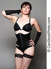 Brunette - Tall pretty brunette dressed in black lingerie