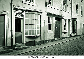 Town buildings - Buildings on a cobbled street in England in...