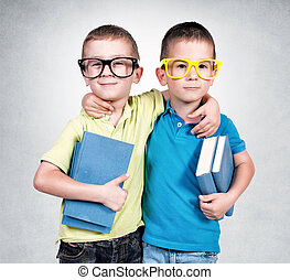 School time - Twins holding books isolated on the gray...