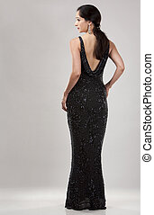 woman in evening dress - beautiful woman in her 40s wearing...