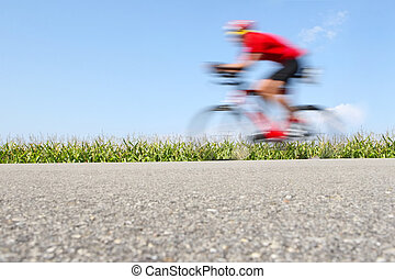 Racing bicycle, motion blur (focus on the cornfield)