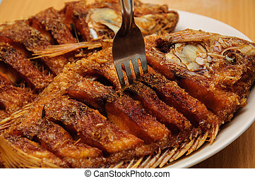 Fried Tilapia fish on the plate