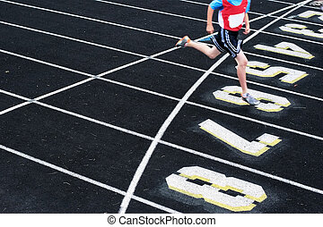 Finish the race - A close up of a runner as he crosses the...