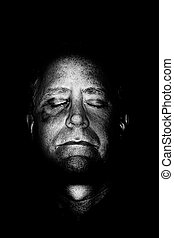 Beaten Man - A dark foreboding image of a man that has been...