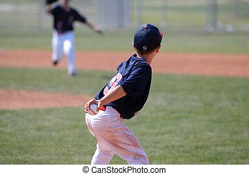 Little league player throwing ball - Little league baseball...