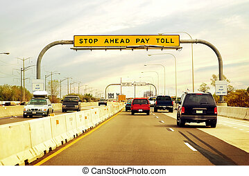 Toll Road - Cars on the highway leading in and out of a toll...