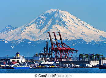 Seattle Port with Red Cranes Ships and Mt Rainier in the...