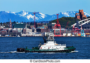 Tug Boat Seattle Port with Red Cranes and Cascade Mountains...