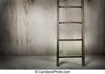 Old wooden ladder on a cement wall - an old wooden ladder is...