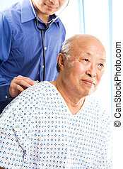 Doctor and patient - A shot of a doctor examining a senior...
