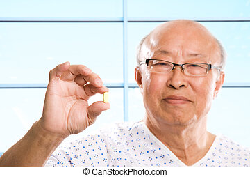 Senior asian healthcare - A shot of a senior asian man...