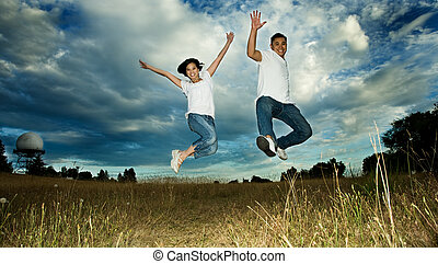 Asian couple jumping in joy - A shot of an asian couple...