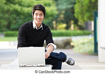 Asian student - A shot of an asian student studying on his...