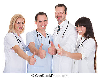 Group Of Doctors With Thumb-up Sign - Group Of Happy Doctors...