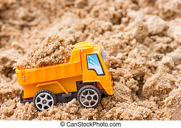 Dump truck fully loaded sand - Construction concept. Orange...