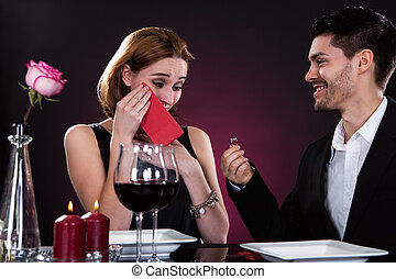 Portrait of couple in restaurant - Portrait of young man...