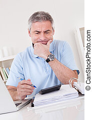 Mature Man Doing Finances - Portrait Of Tired Mature Man...
