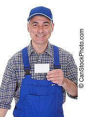 Mature Male Technician Holding Visiting Card Over White...