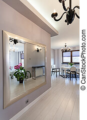 Vibrant cottage - huge mirror in a corridor of modern house