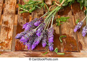Freshly picked and washed lavender on wooden table