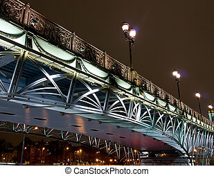 Highlighted bridge over the river at night