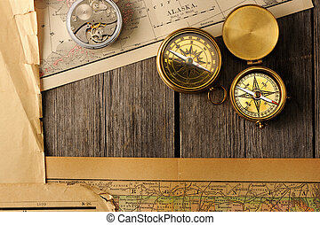 Antique compasses over old map - Antique brass compasses...