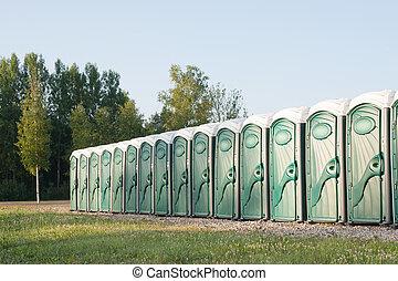 Many portable toilets