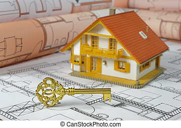 golden key and model house on construction plan