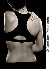 Woman with Shoulder and Back Pain - A black and white photo...