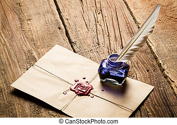Blue ink inkwell and envelope with red sealant