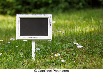 Blank signboard in the meadow straight view - Blank...