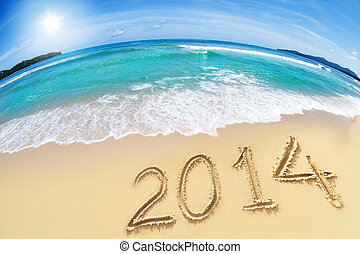 wide angle shot of beach with blue sky and 2014 year digits