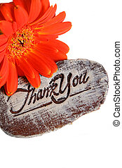 Wooden sign saying Thank You and a flower