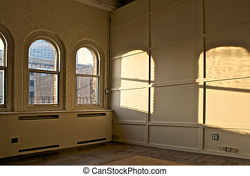 empty room - large empty room in old building with arched...