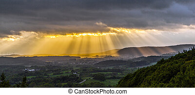 golden sunset at the  mountains of the saarland with dark rain clouds in sunset