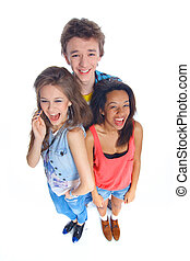 Three young teenagers laughing Isolated on white background...