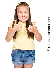 Little girl is showing thumb up gesture - Little girl...