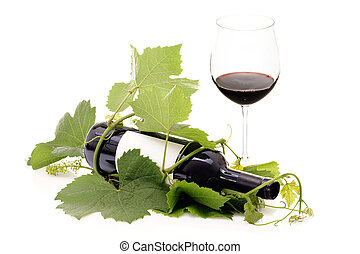 Red wine bottle wrapped in grape vine and glass - Red wine...