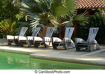 chairs at resort in tropical location