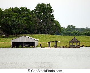 Boat shack on a lake in the summertime