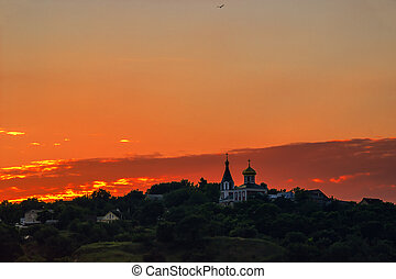 Landscape with church at sunset - Red sunset over the hills....