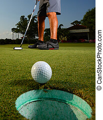 Golfer golfing and close-up of golf ball - Golfer on a...