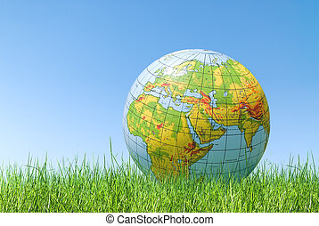 planet earth balloon over grass - inflated topographical...