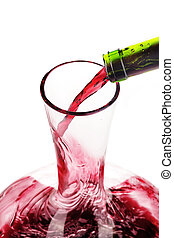 Red wine being poured in a decanter, selective focus