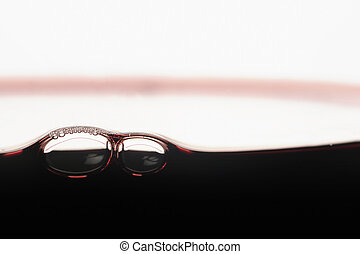Close-up of red wine bubbles in a glass