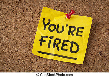 you are fired note - handwriting on orange sticky note