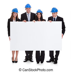 Group Of Architects Holding Placard - Group Of Happy...